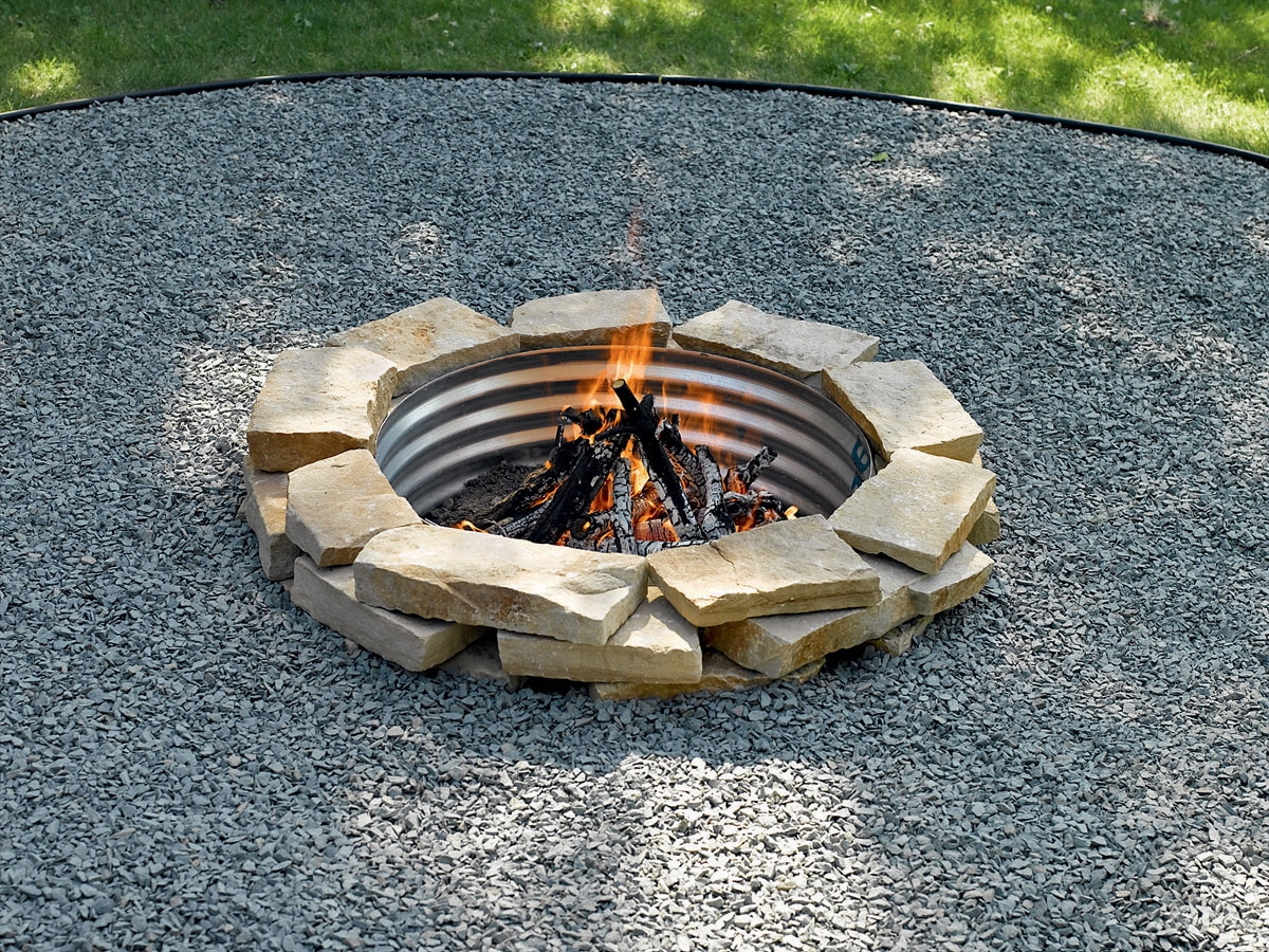 build a cozy firepit in your backyard